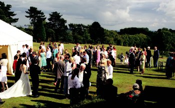 wedding-guests-on-lawn-with-marquee